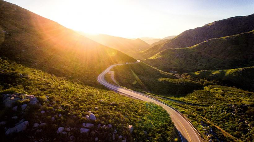 Road winding through the hills at sunrise. Don't give up before you get results. unreasonablehope.com